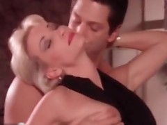 Lauren Hays topless kissing a boy, sucking on his finger wHile tthis chaby hanging out in the kitchen's table, then they have sex from behinde. f