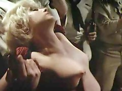 Jennifer jason Leigh intend topless at a bar, stumbling around a bit wHile drunk as some guys pour drinks on that guyr nude breasts, kiss this guyr ch
