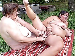 Hefty lesbian babes fucking by the River