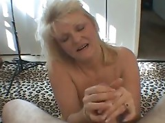 Nasty mom shows her juggs and sucks cock