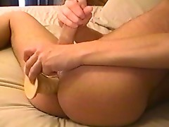 Horny dude jerks his cock and take a huge dildo into her ass !