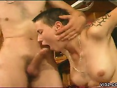 Tied up short haired brunette forced to suck cock