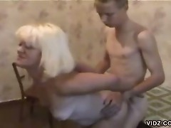 Blonde milf enjoys the cock of a skinny young dude deep in her pussy