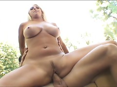 Sexy blonde with big tits rides hard cock outdoors