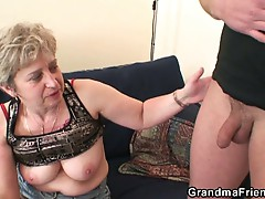 Horny granny rubs pussy before sucking young cock