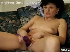 Horny granny pleases her horny pussy