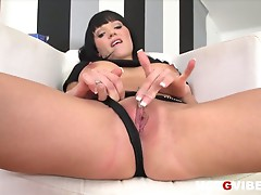 Busty brunette pornstar emma strips to rub her pussy