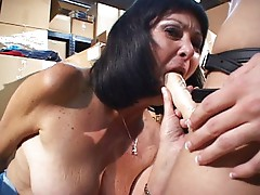 Mature lady does girl in storage depot