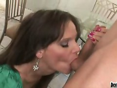 Busty milf devours young cock