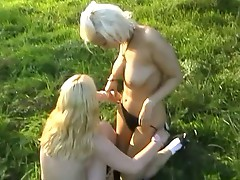 Two european lesbos do each other outdoors