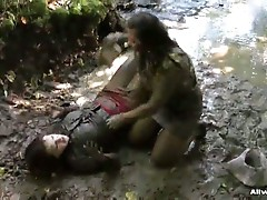 Two babes get into a catfight in the mud getting all dirty for you