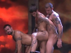 Tattooed studs pounding asses in a wild gay threesome