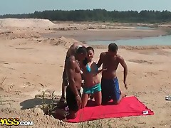 Cute brunette teen on hardcore foursome on the beach