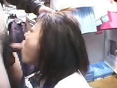 Japanese schoolgirl sucks cock on her knees