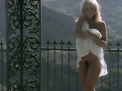 A young pamela anderson strips and shows off