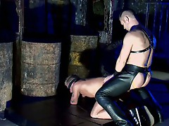 Blindfolded guy fucked in the ass by a hunk in latex