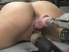 Amateur brunette is trying out a new fuck machine in her pussy