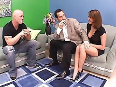 Erika Bella fucks one guy while another sits on the couch and watches