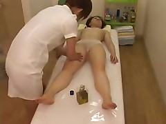Japanese woman gets a full body massage on all of her parts