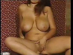 Porn star Kerry Marie shows off her large boobs and pussy