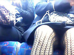 Upskirt on train, patterned tights