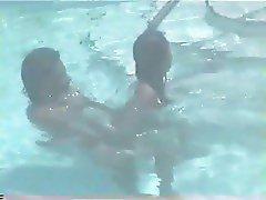 Amateur couple on swimingpool