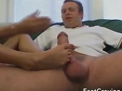 Busty blonde gets her toes sucked