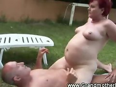 Red haired granny takes cock outdoors