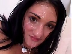 Brunette Gets Her Face Covered in Fresh Cum