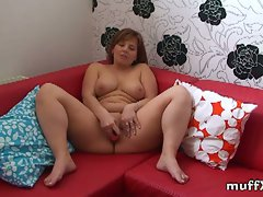 Amateur marie�jeanne masturbates on red sofa
