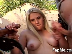Cute girl wanking two hard dicks