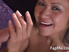Asian chick licking a hard cock
