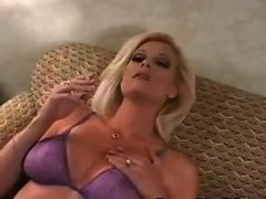 Older girl smokes and rubs pussy