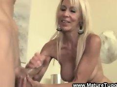 Blonde mature whore wanks cock