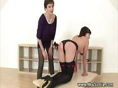 Dominatrix spanking a kinky babe