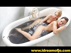 Two hot lesbian babes get in the tub and finger some pussy