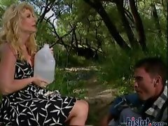 Nina is a mature babe and with her hunky younger man, they go out into the woods to fuck