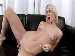 blond babe fingering on leather sofa