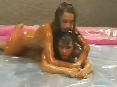 Slippery slimy action with two female oil wrestlers Olga and Melanie