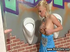 Bimbo massages her tits with bukkake cum