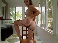 Young hottie cam girl plays with herself on a chair using her fingers