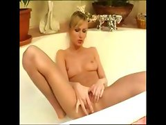 Sexy blonde babe really enjoys her bath especially when she masturbates