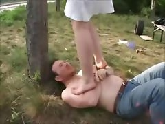 Redheaded wife literally walks all over her submissive hubby at the park