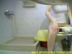 Hidden camera girl pissing in toilet