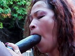Black bitch blowjobing in the pool