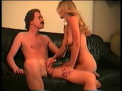Couple having sex on leather couch 1
