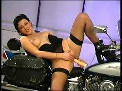 Babe dildoing on motorbike