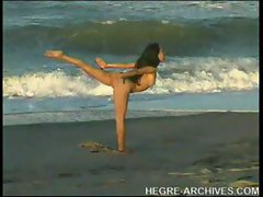 Nude beach yoga by Anahi Flores