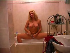 Hot blonde stripping in bath