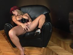 Busty corset wearing Dorothy Black in solo masturbation action